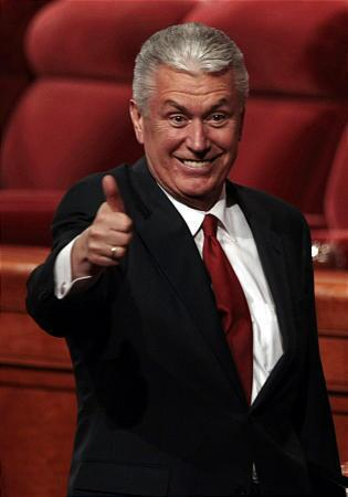 President Uchtdorf gives a thumbs-up to conference-goers in April 2009.