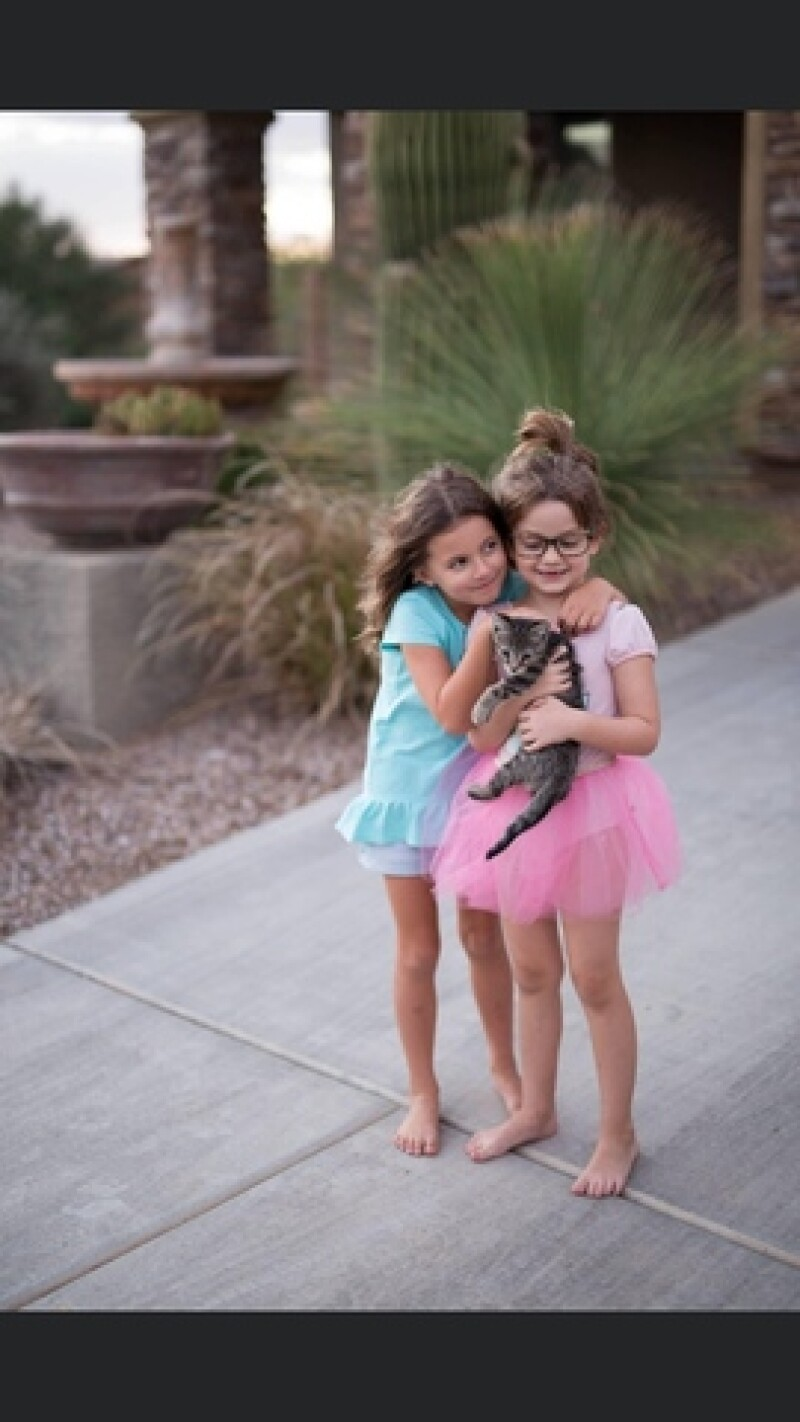 Mel's daughter with their cat, Lucy.