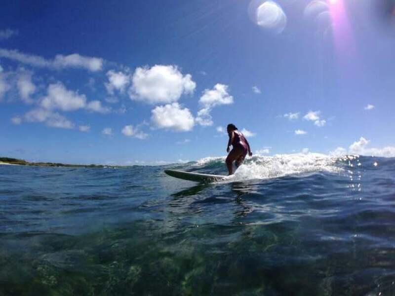 Miya surfing.