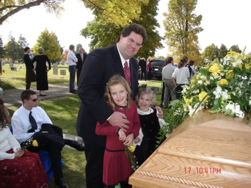 Anna with her dad and sister at her mom's funeral.