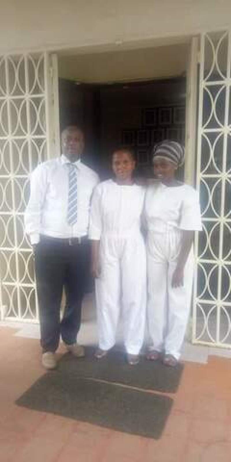 Susan and her daughter on their baptism day with Titus.