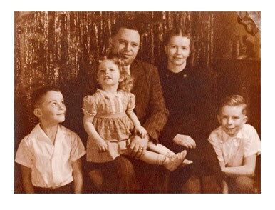 Image titleElder Cook with his parents, older brother, and younger sister. Image from lds.org.