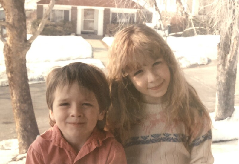 Christie with her brother in their neighborhood in the Avenues.