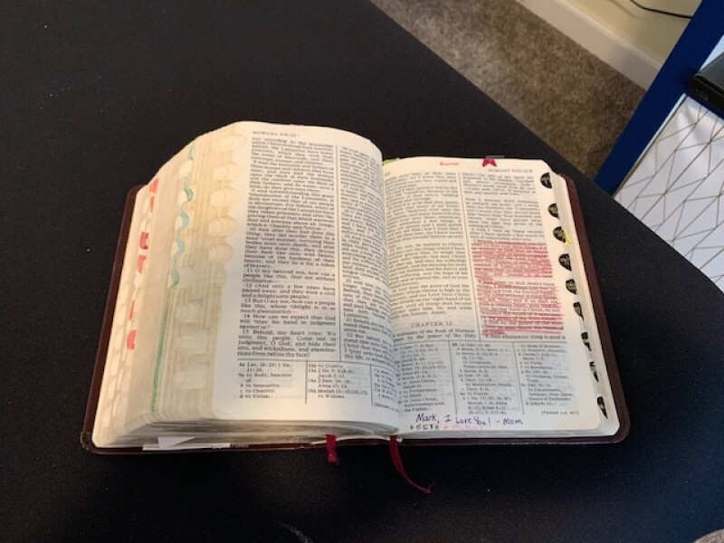 The scriptures that Mark lost on his mission and his brother miraculously found. In these scriptures, Mark's mother had highlighted Moroni 10:3-5 before she gave them to him.