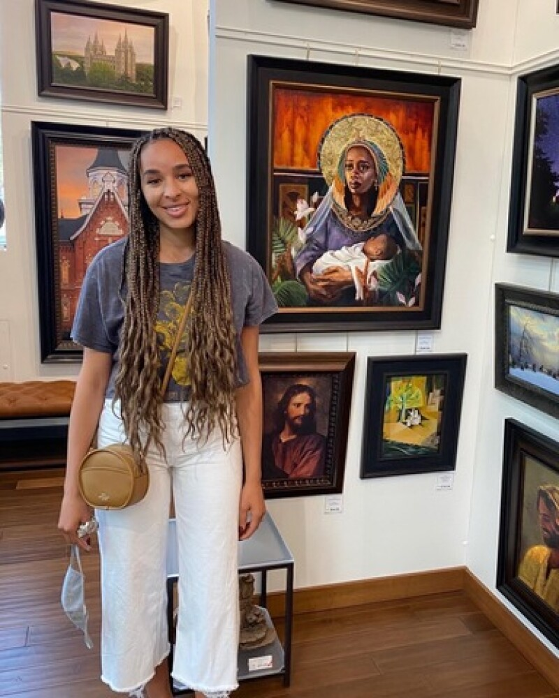 Melissa at the Deseret Book flagship store with her art.