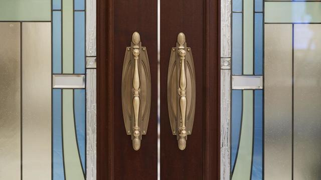 Stained-glass windows enhance the artistry of the doors in the Rome Italy Temple.