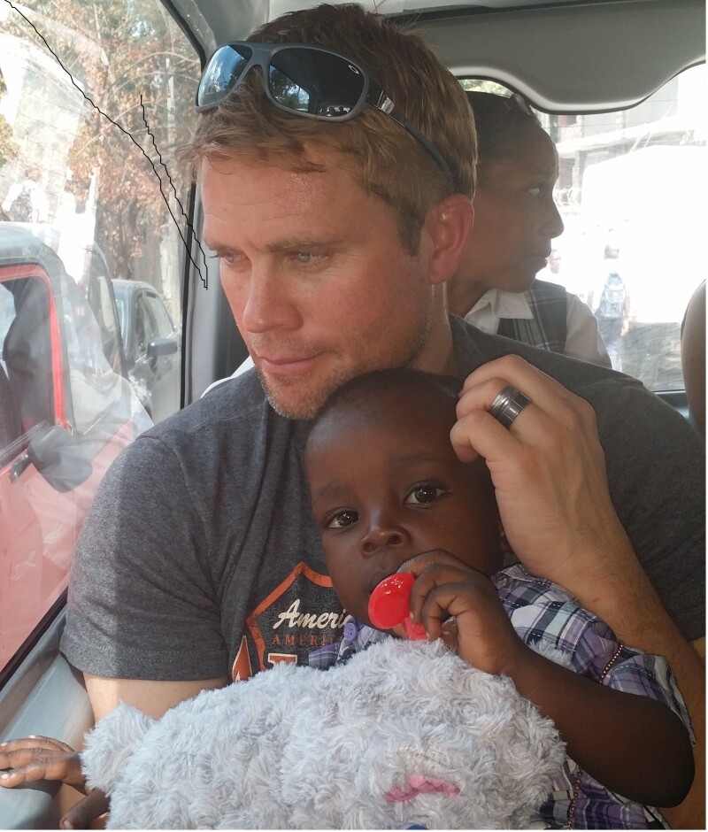 Timothy Ballard with a rescued child