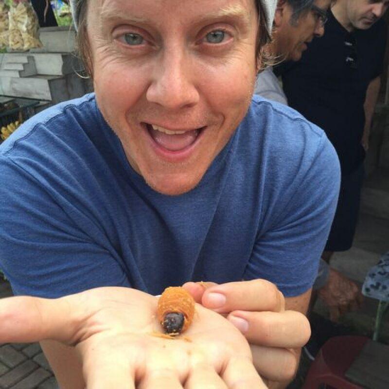 Spencer holding a giant grub worm (a future beetle):
