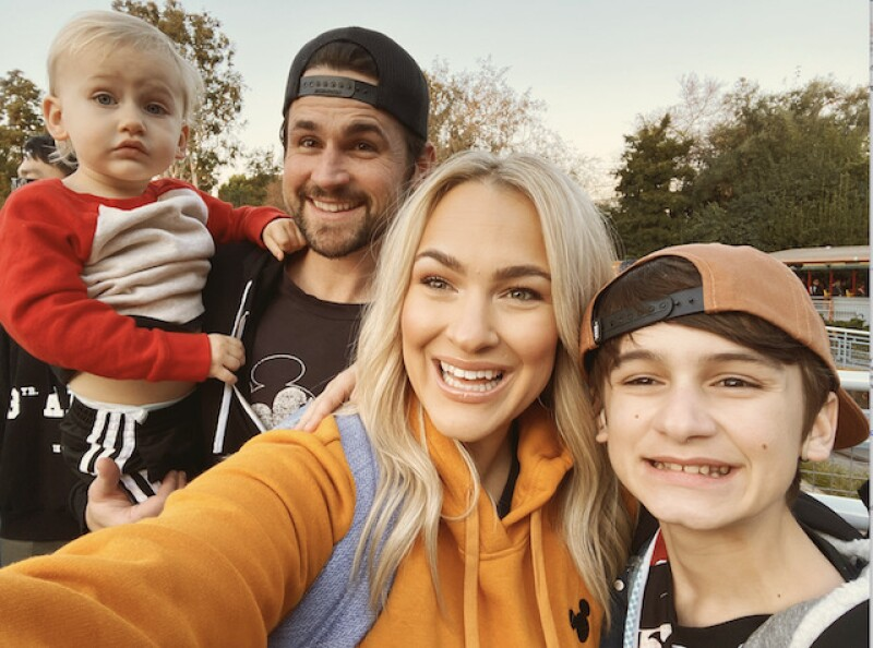 Brooke with her two boys and and her husband.