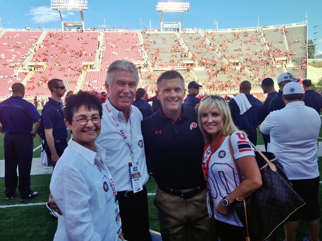 President Uchtdorf and wife Harriet with Coach Whittingham and wife Jamie at a University of Utah football game.