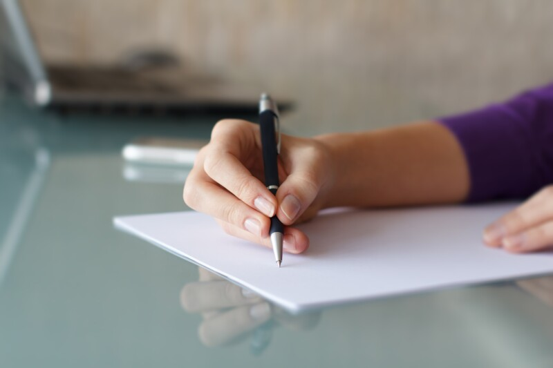 Businesswoman,Writing,With,Pen